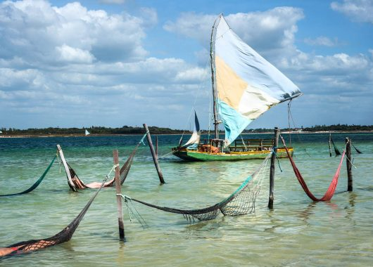 Sail boat and hammocks at the Paradise Lake (Jericoacoara Brazil)