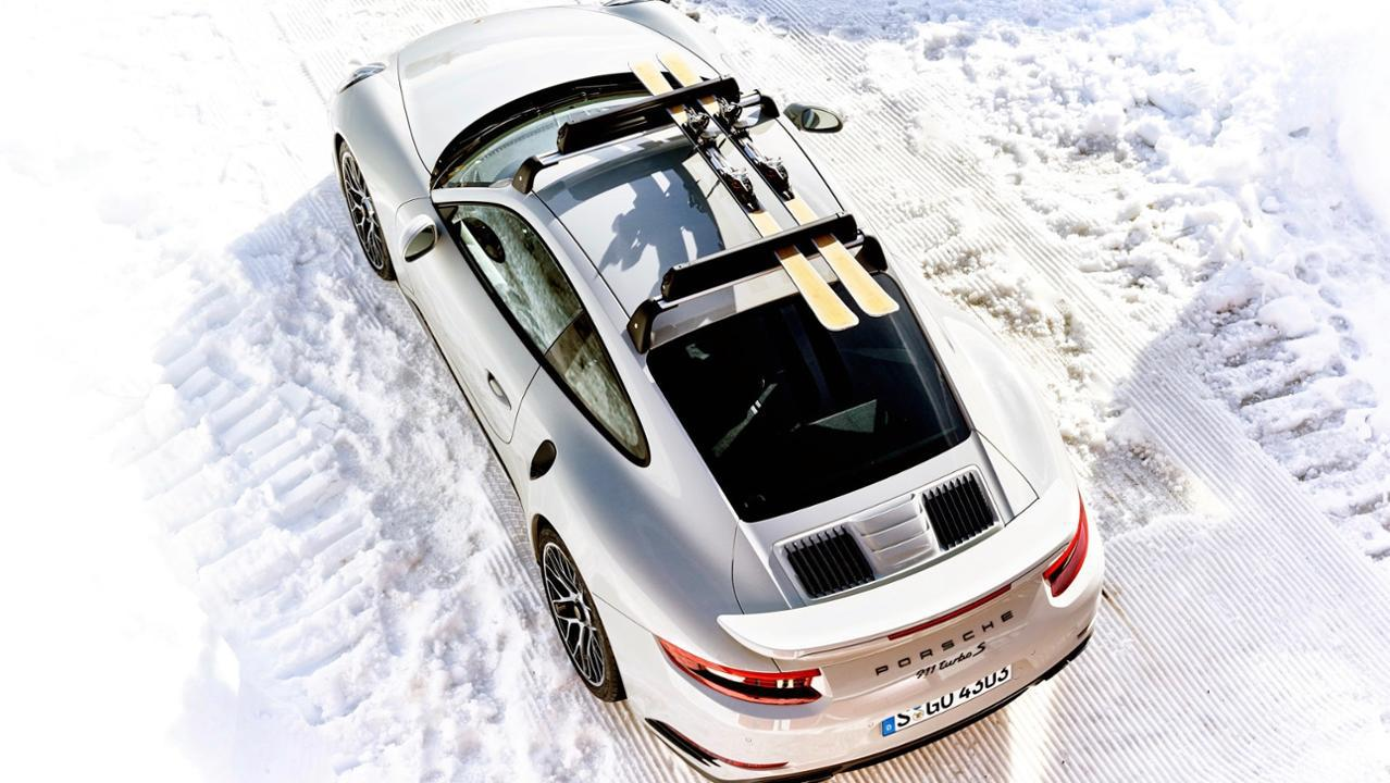 https://newsroom.porsche.com/en/sport-lifestyle/porsche-356-911-turbo-s-swiss-alps-skis-iconic-photograph-drivetribe-marcus-hoffmann-history-repeating-14817.html